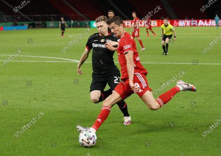 Bayern Munich's Robert Lewandowski (R) in action against Mitchell Weiser (L) of Bayer Leverkusen during the German DFB Cup final between Bayer 04 Leverkusen and FC Bayern Munich at Olympic Stadium in Berlin, Germany, 04 July 2020.