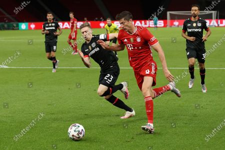 Bayern Munich's Robert Lewandowski (front R) in action against Mitchell Weiser (front L) of Bayer Leverkusen during the German DFB Cup final between Bayer 04 Leverkusen and FC Bayern Munich at Olympic Stadium in Berlin, Germany, 04 July 2020.