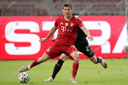 Bayern Munich's Robert Lewandowski (front) in action against Mitchell Weiser (back) of Bayer Leverkusen  during the German DFB Cup final between Bayer 04 Leverkusen and FC Bayern Munich at Olympic Stadium in Berlin, Germany, 04 July 2020.