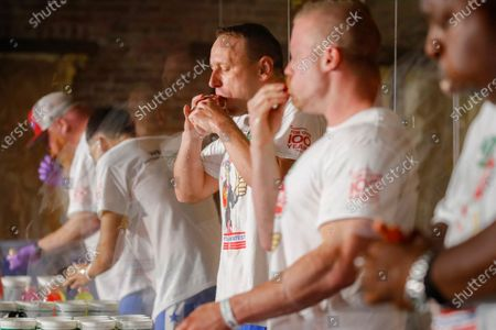 Competitive eater Joey Chestnut sets a new world record with 75 hot dogs to win the men's division of the Nathan's Famous July Fourth hot dog eating contest, in the Brooklyn borough of New York