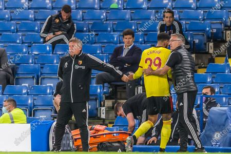 Craig Shakespeare, Assistant Coach of Watford FC & Nigel Pearson, Head Coach of Watford FC thank Etienne Capoue (Watford) as he comes off during the Premier League match between Chelsea and Watford at Stamford Bridge, London