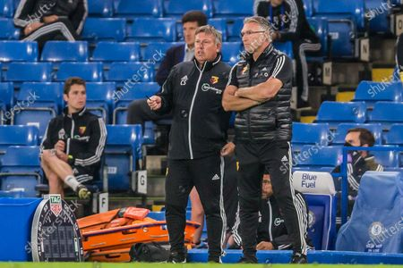Craig Shakespeare, Assistant Coach of Watford FC & Nigel Pearson, Head Coach of Watford FC talking during the Premier League match between Chelsea and Watford at Stamford Bridge, London