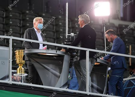 Former Bayern Munich teammates Bastian Schweinsteiger (C), in his role as Tv pundit, and Oliver Kahn (L), board member of Bayern Munich, prior to the German DFB Cup final soccer match between Bayer Leverkusen and Bayern Munich in Berlin, Germany, 04 July 2020.