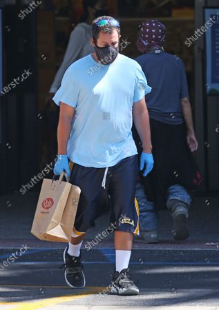 Stock Photo of Adam Sandler stops at the market in Malibu
