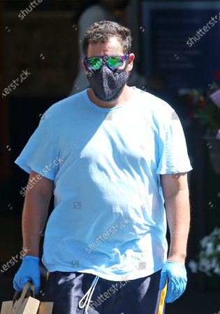 Stock Image of Adam Sandler stops at the market in Malibu