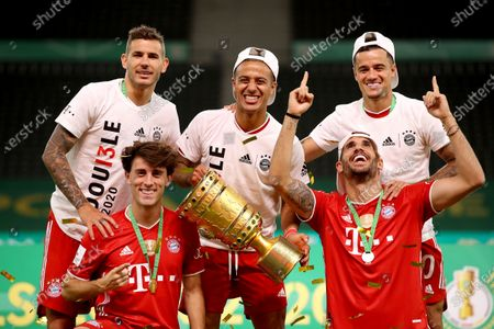 (L-R) Lucas Hernandez, Alvaro Odriozola, Thiago Alcantara, Javier Martinez and Philippe Coutinho of FC Bayern Munich pose with the trophy after winning the DFB Cup final match between Bayer 04 Leverkusen and FC Bayern Munich at Olympiastadion in Berlin, Germany, 04 July 2020.