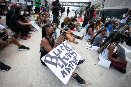 People protest on Independence Day in front of the CNN Center in downtown Atlanta. BLM protests have started over the death of George Floyd, an unarmed black man who died after being pinned down by a white police officer.