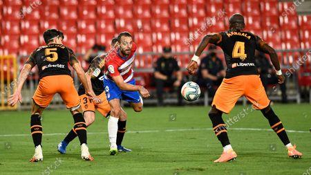 Granada Cf player Roberto Soldado and Valencia CF player Eliaquim Mangala are seen in action during the La Liga match between Granada CF and Valencia FC at Nuevo Los Carmenes Stadium. (Final score; Granada CF 2:2 Valencia FC)