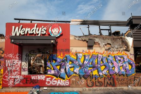 A memorial is made at the Wendy's where Rayshard Brooks was killed, which has now become a center for activism after being burned down.