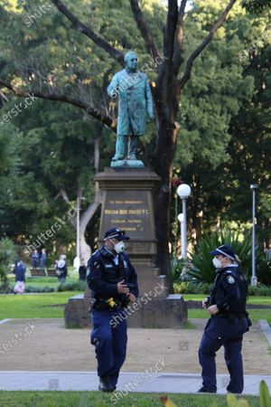Pictured: Police guard the statues in Hyde Park, nearby.
