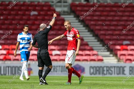Stock Picture of Middlesbrough midfielder George Saville (22) is shown a yellow card by the referee Scott Duncan during the EFL Sky Bet Championship match between Middlesbrough and Queens Park Rangers at the Riverside Stadium, Middlesbrough