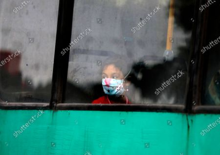 Girl wearing a protective face mask to help prevent the spread of the coronavirus travels on a public bus in the city of Zanjan, some 330 kilometers (205 miles) west of the capital Tehran, Iran, . Iran on Sunday instituted mandatory mask-wearing as fears mount over newly spiking reported deaths from the coronavirus, even as its public increasingly shrugs off the danger of the COVID-19 illness it causes