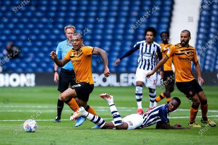 Josh Magennis of Hull City goes past Rekeem Harper of West Bromwich Albion