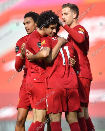 Curtis Jones (2-L) of Liverpool celebrates with team mates Trent Alexander-Arnold (L), Jordan Henderson (R) and Mohamed Salah (2-R) after scoring the 2-0 goal during the English Premier League soccer match between Liverpool FC and Aston Villa at Anfield stadium in Liverpool, Britain, 05 July 2020.