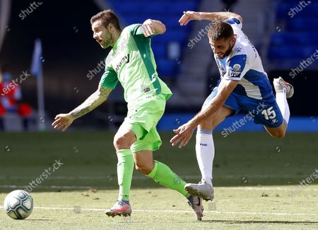 Espanyol's David Lopez (R) in action against Leganes' Aitor Ruibal (L) during the Spanish La Liga soccer match between RCD Espanyol and CD Leganes at RCDE Stadium in Barcelona, north-eastern Spain, 05 July 2020.