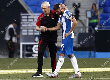 Espanyol's David Lopez (R) is comforted by Leganes' head coach Javier Aguirre (L) during the Spanish La Liga soccer match between RCD Espanyol and CD Leganes at RCDE Stadium in Barcelona, north-eastern Spain, 05 July 2020.