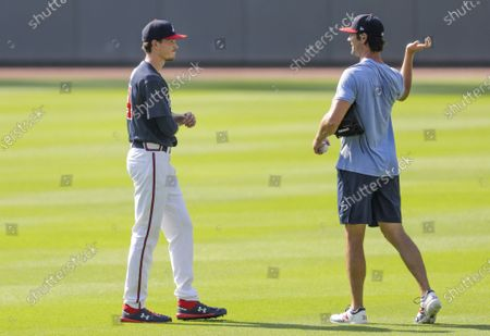 Atlanta Braves' Max Fried, left, talks with Cole Hamels, right during team practice at Truist Park, in Atlanta