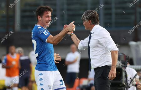 Brescia's Andrea Papetti (L) celebrates with his coach Diego Lopez (R) after scoring the 1-0 lead during the Italian Serie A soccer match between Brescia Calcio and Hellas Verona at the Mario Rigamonti stadium in Brescia, Italy, 05 July 2020.