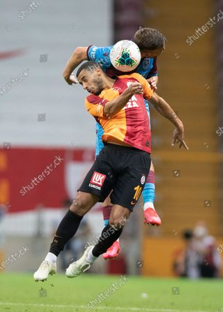 Galatasaray's Younes Belhanda (L) in action against Trabzonspor's Filip Novak (R) during the Turkish Super League soccer match between Galatasaray and Trabzonspor in Istanbul, Turkey, 05 July 2020.
