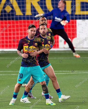 FC Barcelona players (ftont to back) Lionel Messi, Jordi Alba, and Arturo Vidal warm up ahead of the Spanish La Liga soccer match between Villarreal CF and FC Barcelona at La Ceramica stadium in Villarreal, eastern Spain, 05 July 2020.