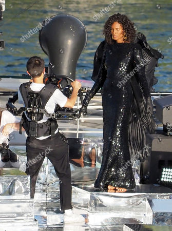 """Model Cindy Bruna wears a black dress during the """"Balmain"""" sur seine"""" Fashion show that was held on a """"peniche"""" Parisian boat on the seine river to celebrate the 75th anniversary of the brand during the Couture Paris fashion week on July 05, 2020 in Paris, France."""