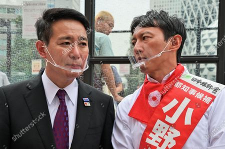 Stock Picture of Member of the House of Representatives Seiji Maehara(L) and candidate Taisuke Ono attend the campaign speeches for the Tokyo gubernatorial election near Shinjuku station in Tokyo, Japan.