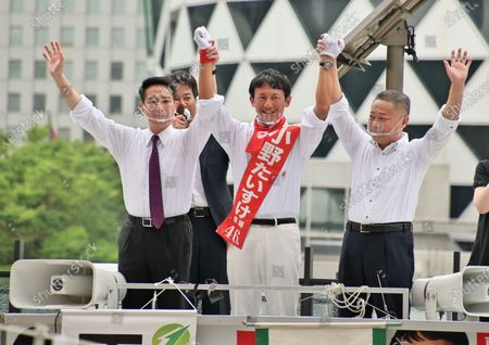 (L-R)Member of the House of Representatives Seiji Maehara, candidate Taisuke Ono and Secretary General of Restoration Party, Nobuyuki Baba attend the campaign speeches for the Tokyo gubernatorial election near Shinjuku station in Tokyo, Japan.