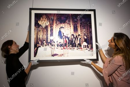 'Baccarat, Paris, 2007', being hung in the gallery.