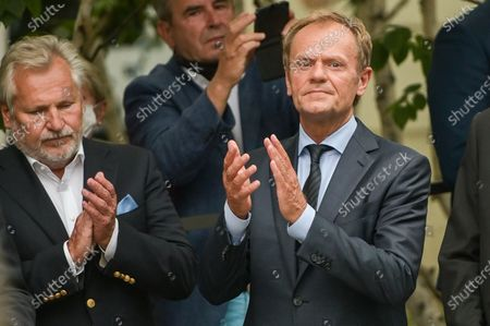 Former President of Poland, Aleksander Kwasniewski (L) and former President of European Council Donald Tusk (R) applaud the unveiling of the monument to Wladyslaw Bartoszewski in Sopot. Wladyslaw Bartoszewski was a Polish historian, publicist, journalist, writer, social activist, politician and diplomat. Auschwitz prisoner, Home Army officer, activist of the Polish Underground State, participant in the Warsaw Uprising.