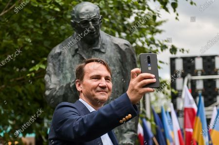 Radoslaw Sikorski takes a selfie during the unveiling of the monument to Wladyslaw Bartoszewski in Sopot. Wladyslaw Bartoszewski was a Polish historian, publicist, journalist, writer, social activist, politician and diplomat. Auschwitz prisoner, Home Army officer, activist of the Polish Underground State, participant in the Warsaw Uprising.