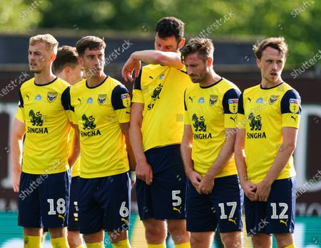 Mark Sykes, Alejandro Rodriguez Gorrin, Elliott Moore, James Henry and Sam Long of Oxford United line up to defend a Portsmouth free-kick