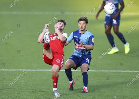 Callum Connolly of Fleetwood Town under pressure from Dominic Gape of Wycombe Wanderers