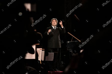 Stock Photo of At the foot of the Temple of Neptune, in the archaeological park of Paestum, the event '' The Ways of Friendship, Concert for Syria '' was held, in memory of the Kurdish activist Hervin Khalaf (1984-2019). The conductor Riccardo Muti conducts the Luigi Cherubini Youth Orchestra and the musicians of the Syrian Expat Philharmonic Orchestra. Kurdish singer Aynur Dogan opened the concert.