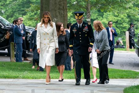 First Lady Melania Trump, escorted by U.S. Army Gen. Omar Jones, walks with Second Lady Karen Pence and Mrs. Leah Esper, wife of Defense Secretary Mark Esper, after arriving at Arlington National Cemetery to participate in a Memorial Day wreath laying ceremony at the Tomb of the Unknown Soldier Monday, in Arlington, V
