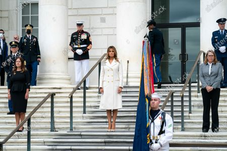 Stock Image of First Lady Melania Trump, joined by Second Lady Karen Pence and Mrs. Leah Esper, wife of Defense Secretary Mark Esper, participate in a Memorial Day wreath laying ceremony at the Tomb of the Unknown Soldier at Arlington National Cemetery Monday, in Arlington, Va.