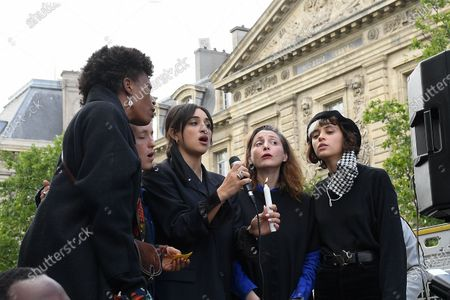 "Singers (Camelia Jordana, Pomme Jeanne Added) sing ""We shall overcome"" during a protest in memory of Georges Floyd"