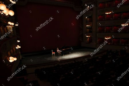 Stock Picture of Pianist Beatrice Rana performs at La Scala theater in Milan Italy, . La Scala opera house reopened Monday after a four-month shutdown due to the COVID-19 restriction measures