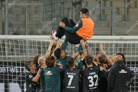Bremen's players toss Bremen's Claudio Pizarro in the air as they celebrate after the German Bundesliga relegation playoff, second leg soccer match between 1. FC Heidenheim and Werder Bremen in Heidenheim, Germany, 06 July 2020.