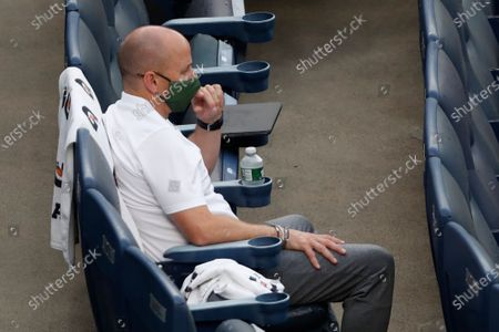 New York Yankees general manager Brian Cashman watches the baseball team's intrasquad game, at Yankee Stadium in New York