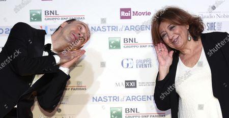 Roberto Benigni and Italian journalist Laura Delli Colli, president of SNGCI