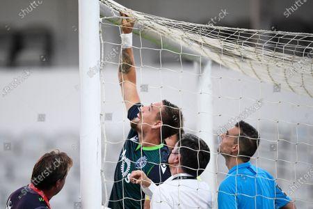 Sporting's Sebastian Coates (C) checks the goal net before the Portuguese First League soccer match between Moreirense FC and Sporting CP held at Comendador Joaquim de Almeida Freitas Stadium, in Moreira de Conegos, Guimaraes, Portugal, 06 July 2020.