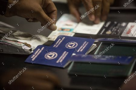 View of the diplomatic passports that the brothers Luis Enrique and Ricardo Alberto Martinelli Linares, children of the former Panamanian President Ricardo Martinelli, used to travel with, as they remain detained in the Tower of Courts in Guatemala City, Guatemala, 06 July 2020. According to official sources, both brothers intended to leave Guatemala for Panama on a humanitarian flight when authorities detained them. The spokesman for the National Civil Police, Jorge Aguilar, explained that the two brothers, of Italian and Panamanian nationality, are accused of 'conspiracy to commit money laundering involving specific activity according to the United States code'.
