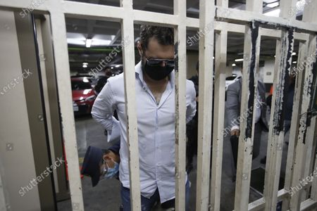 The son of former Panamenian President Ricardo Martinelli, Ricardo Martnelli Linares, is frisked by an officer before a hearing at the judicial court building in Guatemala City, . Guatemalan police detained Ricardo Martnelli Linares and his borther Luis Enrique Martnelli Linares on an Interpol warrant for money laundering, as they attempted to board a private plane out of the country