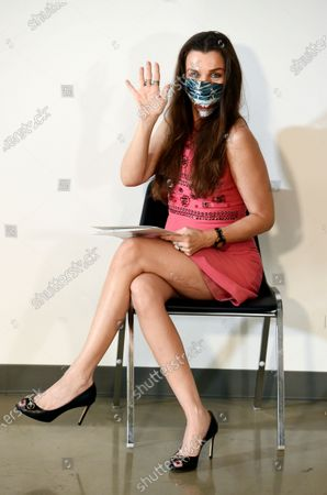 Model Alicia Arden poses before a news conference at the Allred, Maroko & Goldberg law offices, in Los Angeles. Arden said she was sexually assaulted and battered by the late financier Jeffrey Epstein in 1997 at the Shutters on the Beach hotel in Santa Monica, Calif., but that she was never contacted by police or any prosecutor after filing a police report with the Santa Monica Police Dept