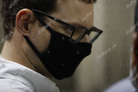 Luis Enrique Martinelli Linares, son of former Panamanian President Ricardo Martinelli, listens to his lawyers before a hearing at the judicial court building in Guatemala City, . Guatemalan police detained the Martinelli brothers, Luis Enrique and Ricardo, on an Interpol warrant for money laundering, as they attempted to board a private plane out of the country