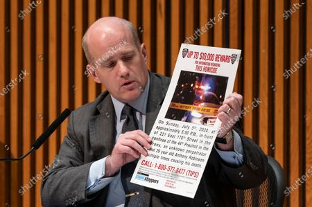Assistant Chief Jason Wilcox holds flyer offering award for information leading to arrest of killer of Anthony Robinson. Gun violence is up in the city by more than 50% following COVID-19 pandemic, police reform and protests after George Floyd murder by Minneapolis police officer.