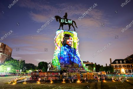 A photograph of Breonna Taylor, who was killed in her own apartment by Louisville, Kentucky police officers, is projected onto a statue of Confederate General Robert E. Lee on Monument Avenue in Richmond, Virginia, USA, 06 July 2020. While other Confederate statues along Monument Avenue are coming down, a lawsuit is temporarily preventing the Lee statue from being removed.