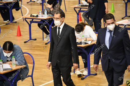 Moroccan Prime Minister Saad Eddine El Othmani (C) inspects a college entrance exam in Rabat, Morocco, on July 6, 2020. Morocco registered 164 new coronavirus cases on Monday, raising the total number in the North African country to 14,379, the health ministry said.