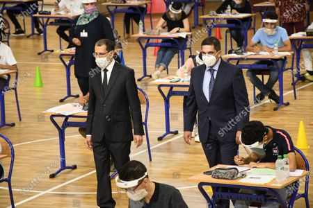 Moroccan Prime Minister Saad Eddine El Othmani (C-L) inspects a college entrance exam in Rabat, Morocco, on July 6, 2020. Morocco registered 164 new coronavirus cases on Monday, raising the total number in the North African country to 14,379, the health ministry said.