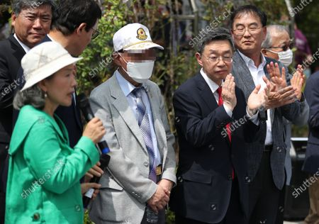 Former South Korean prisoner of war (front row, 2-L), only identified by his family name Han, holds a news conference at the Seoul Central District Court in Seoul, South Korea, 07 July 2020. Han won a damage suit against North Korean leader Kim Jong-un. Han and another POW, just known as Noh, who were taken to North Korea during the 1950-53 Korean War and defected to South Korea in 2000, filed the suit in October 2016, citing their forced labor in the North. The court ordered North Korean leader Kim to pay 21 million won (17,565 US dollar) in compensation to each.